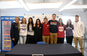 Student athletes sign to play sports in college