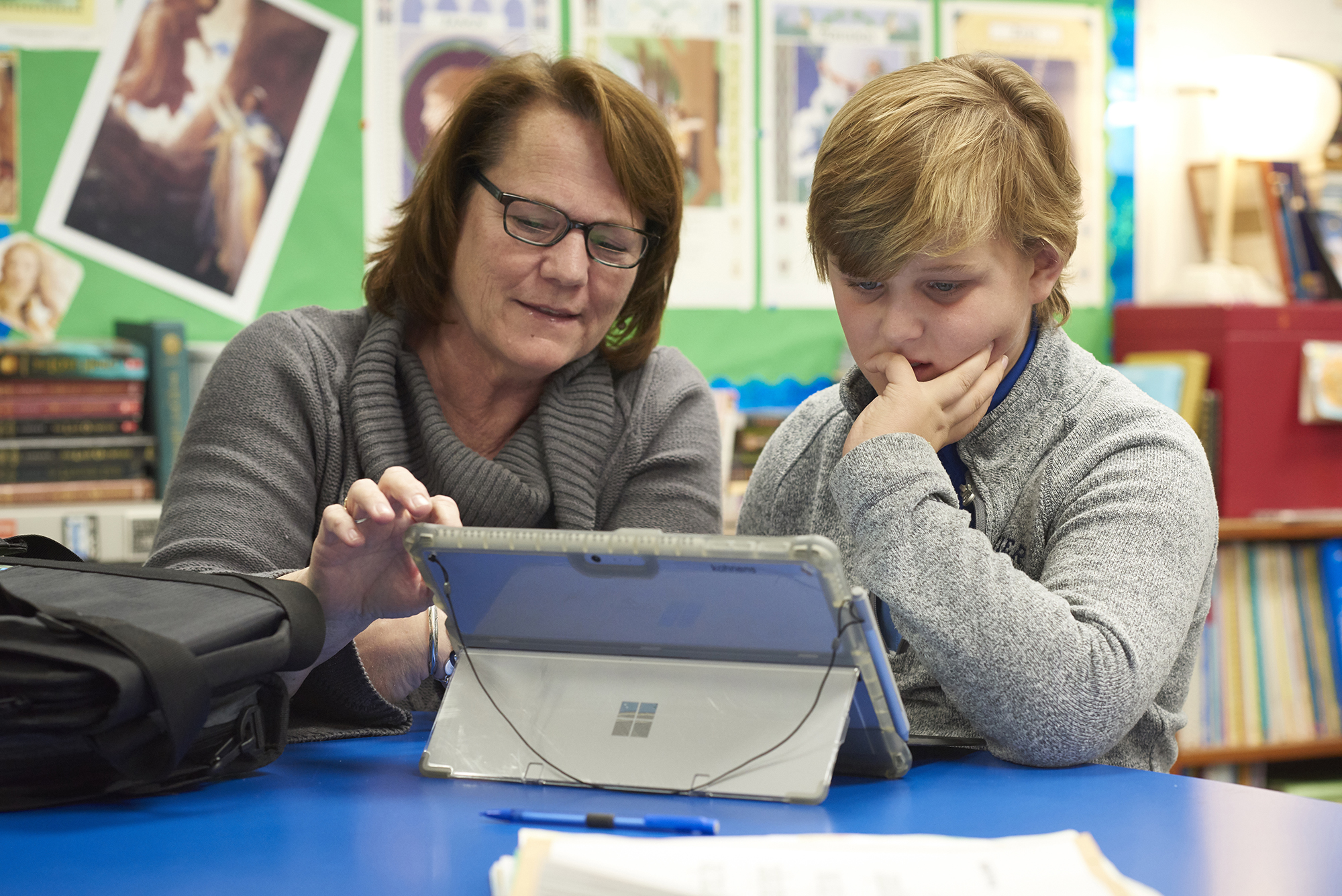 Teacher and student using tablet