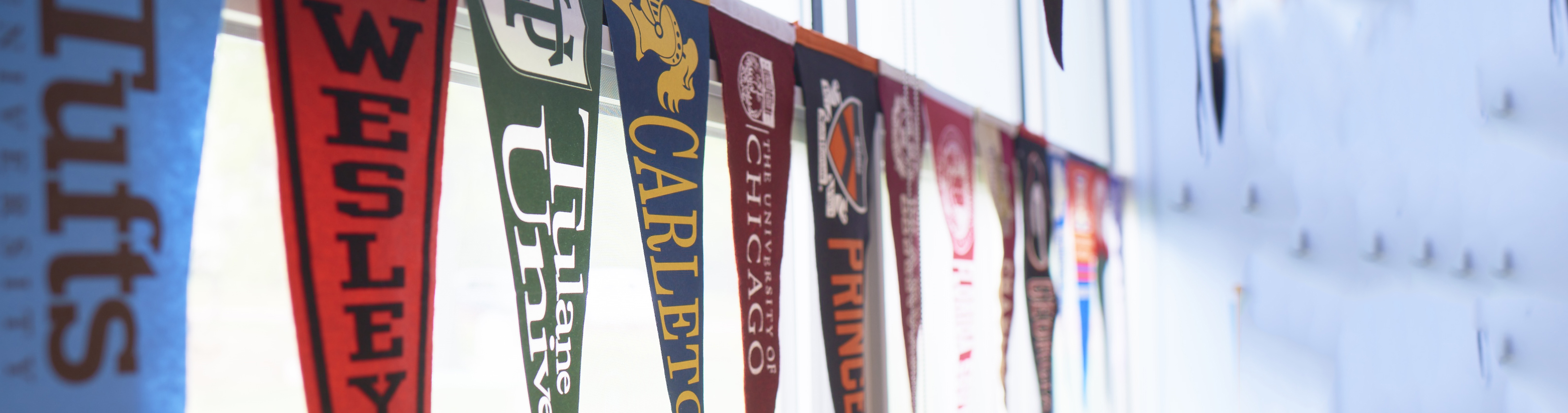 college pennants hanging in window