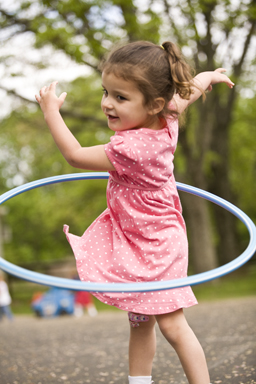 girl with hula-hoop outside